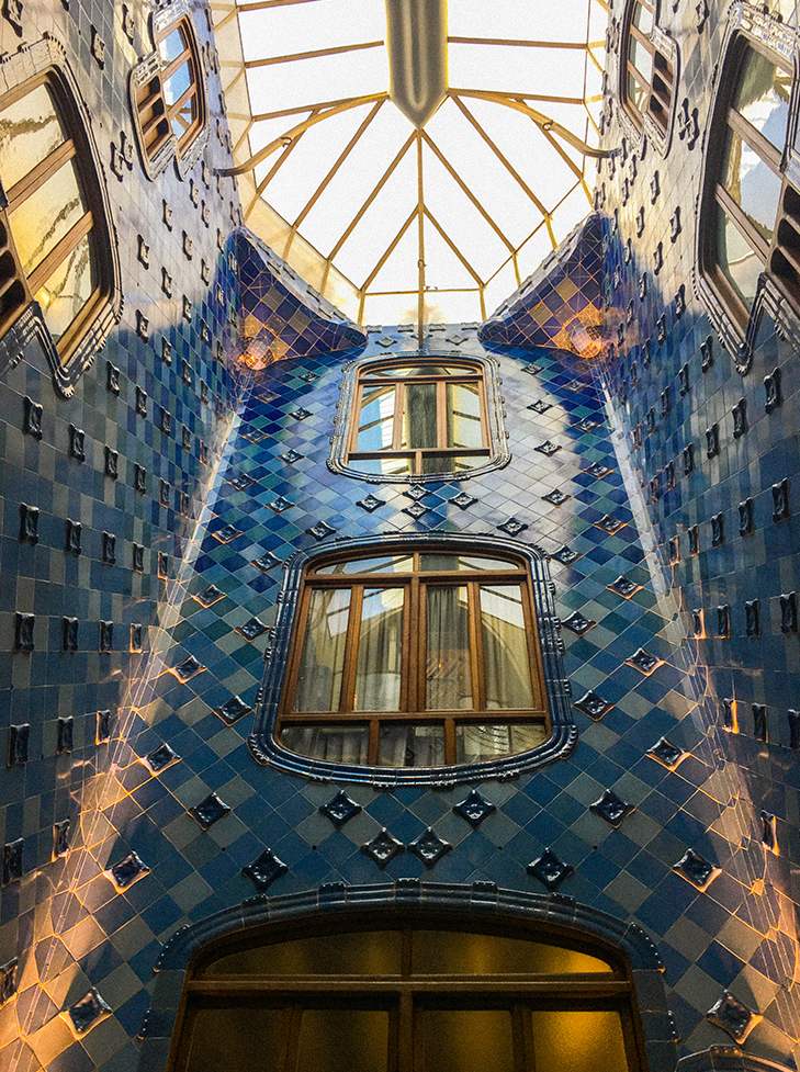 Bright glazed blue tiles are found in Casa Batlló stair well. Photo by May Leong.