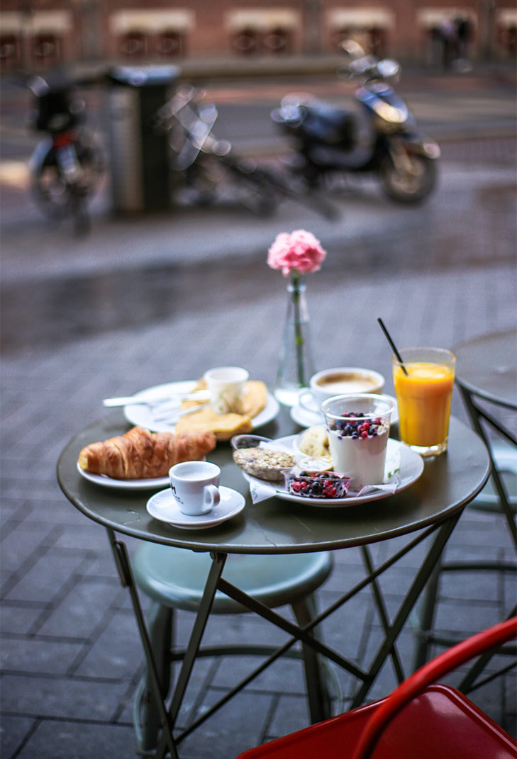Breakfast spread at Hotel The Exchange's Cafe STOCK, located on the iconic Damrak Street. Image by May Leong.