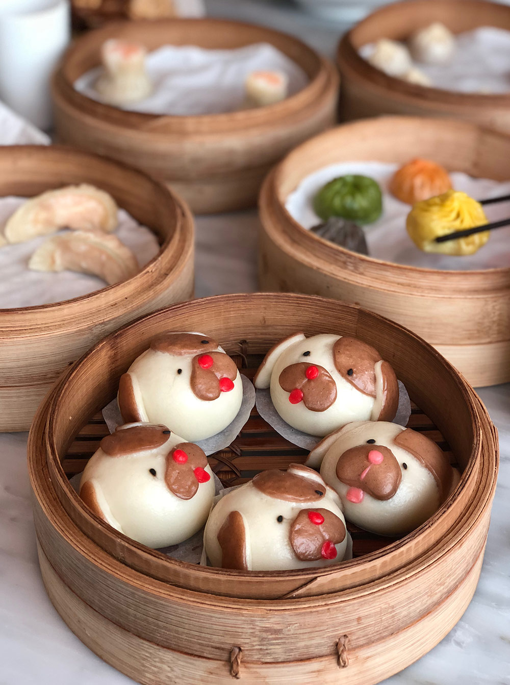 Cute buns with puppy faces. Only available at Din Tai Fung.