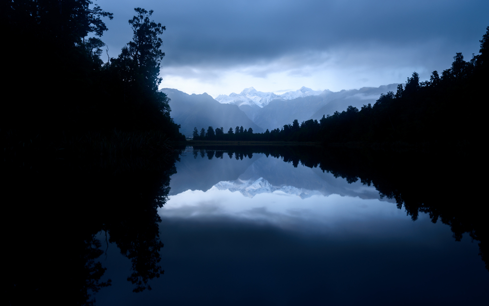 Lake Matheson well before dawn, Mt Tasman centre frame and Mt Cook just to the right