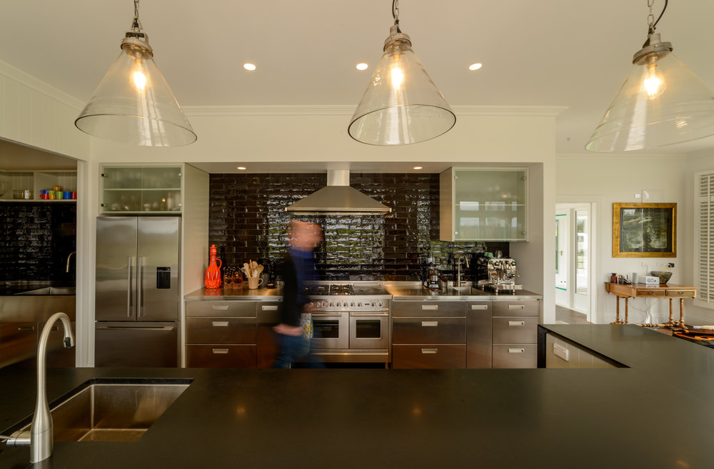 The kitchen is a mix of traditional farmhouse and modern semi-commercial