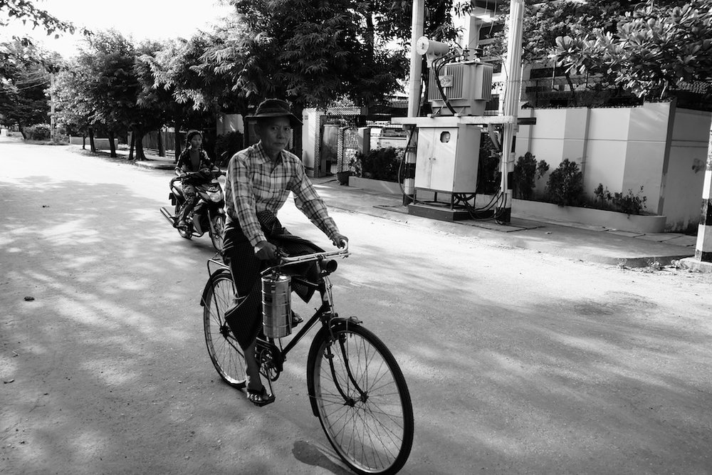 Man on bicycle, with lunch