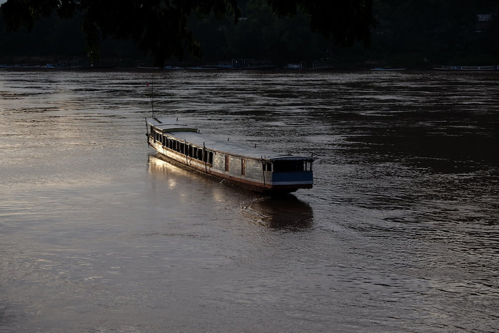 Slow boat on the Mekong at sunset