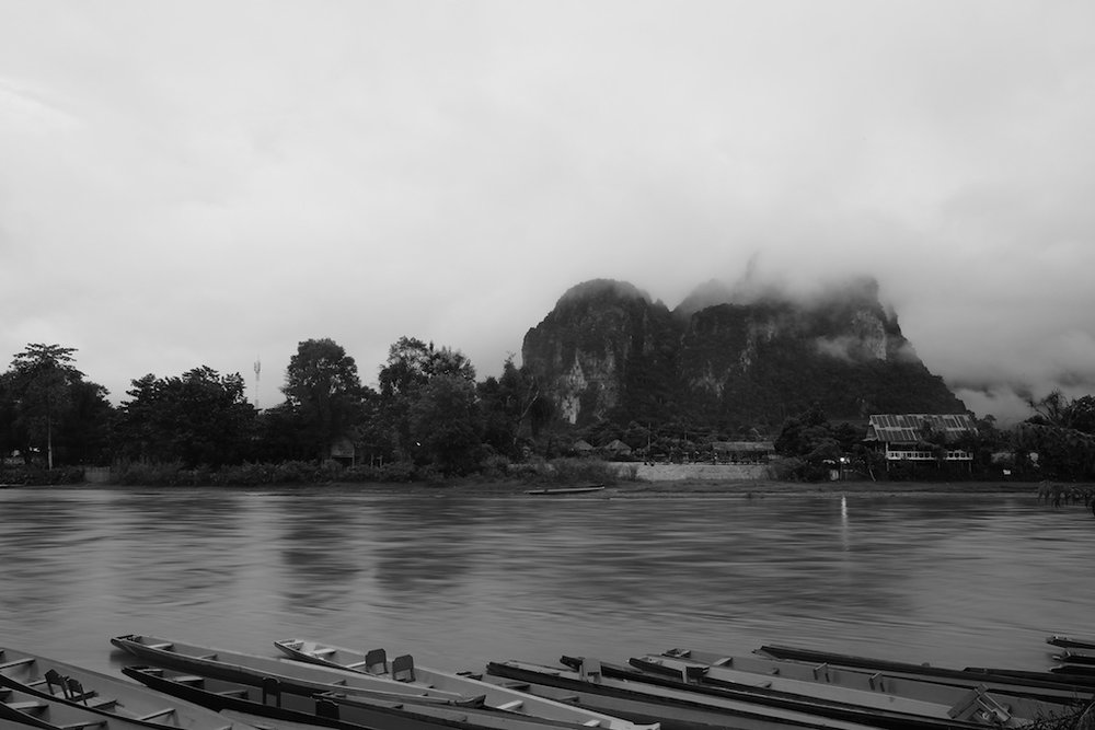Boats, river, mountains, rain