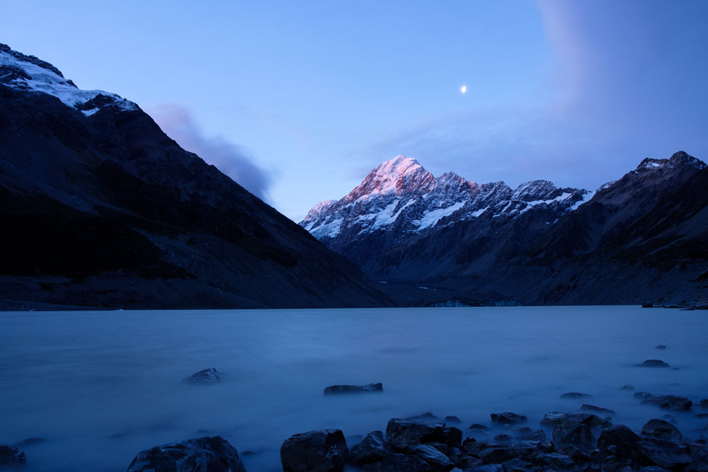 The last light of the day kisses the top of Mt Cook from Hooker Lake