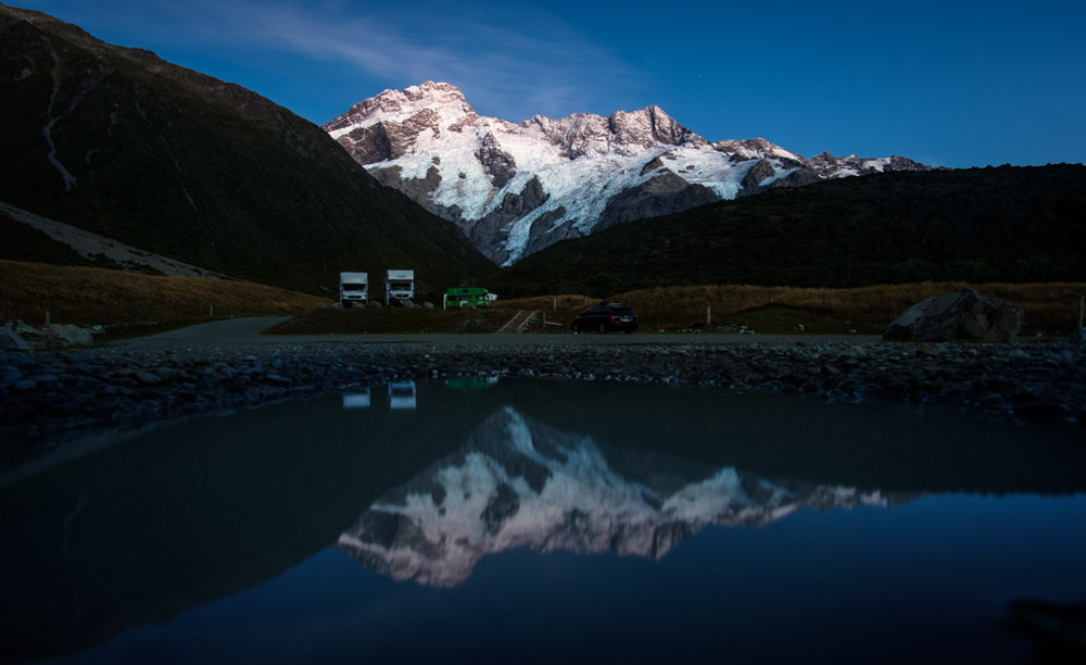 Mt Sefton and friends reflecting in a small lake in the camp