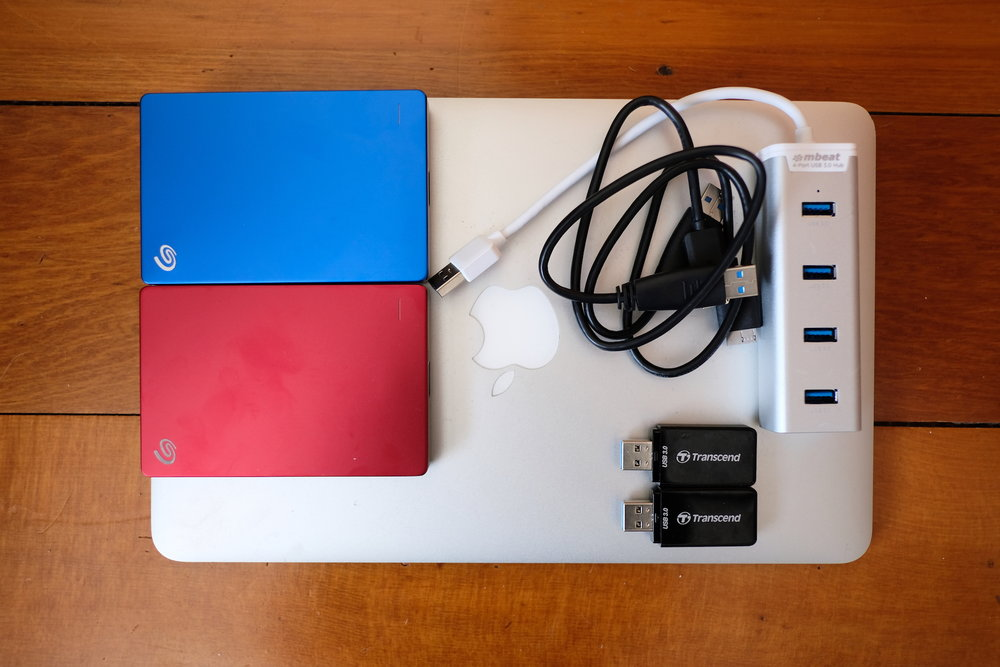 "11"" Macbook Air, 2x Seagate 1 TB HDD's, 2x Transcend SD Card Readers, and mBeat USB 3 hub"