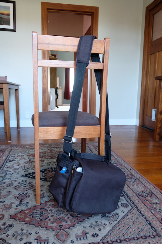 Bag hanging on chair for scale