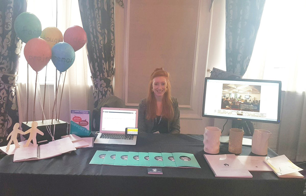 Our Project Manager Emilie Brotherhood at the Created Out of Mind stand- demonstrating some smart tech and arts created with people with dementias for the Alzheimer's Society Annual Conference 2017 in London.