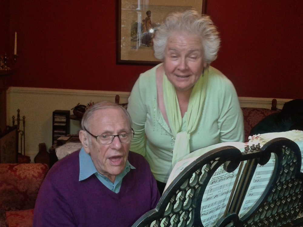 Kate with her husband John, a jazz musician, on the piano
