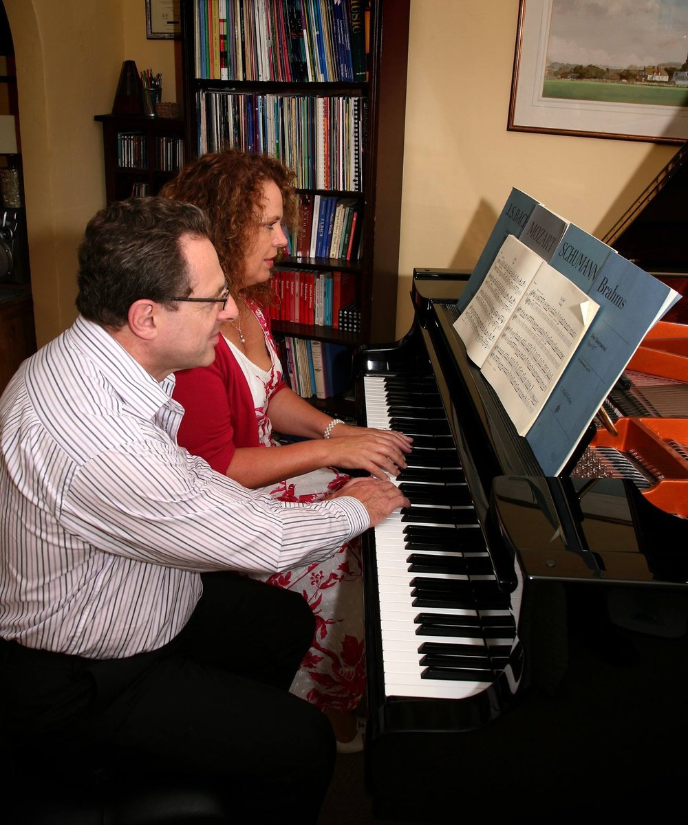 Lorraine and Raymond Banning on the piano