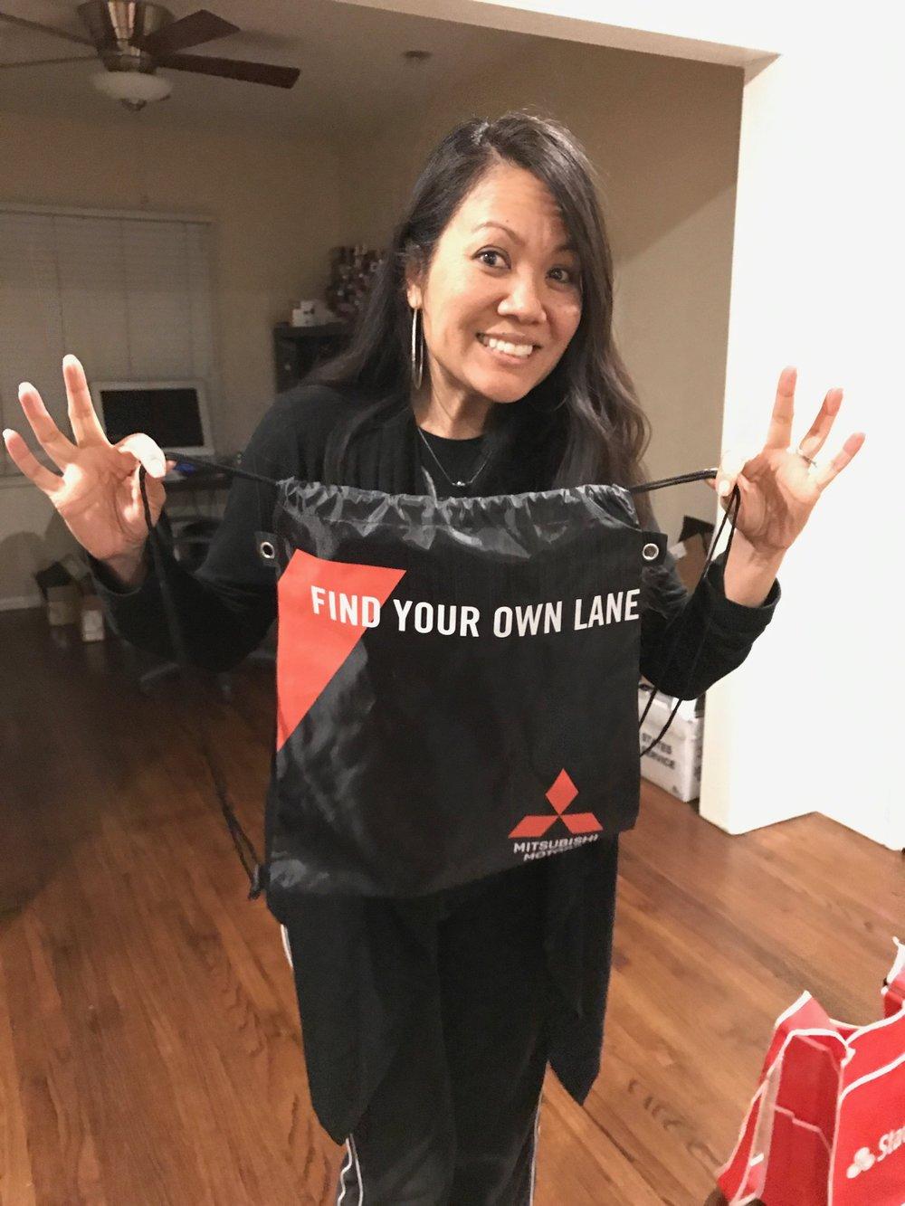 Free drawstring knapsack from Mitsubishi