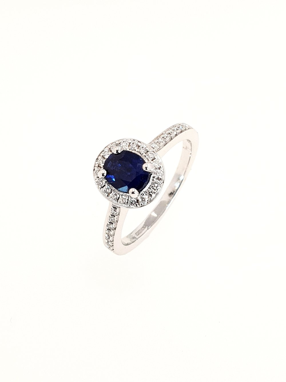 18ct White Gold Sapphire & Diamond Ring  Diamond: .19ct, G, Si1  Stock Code: N8945  £1900