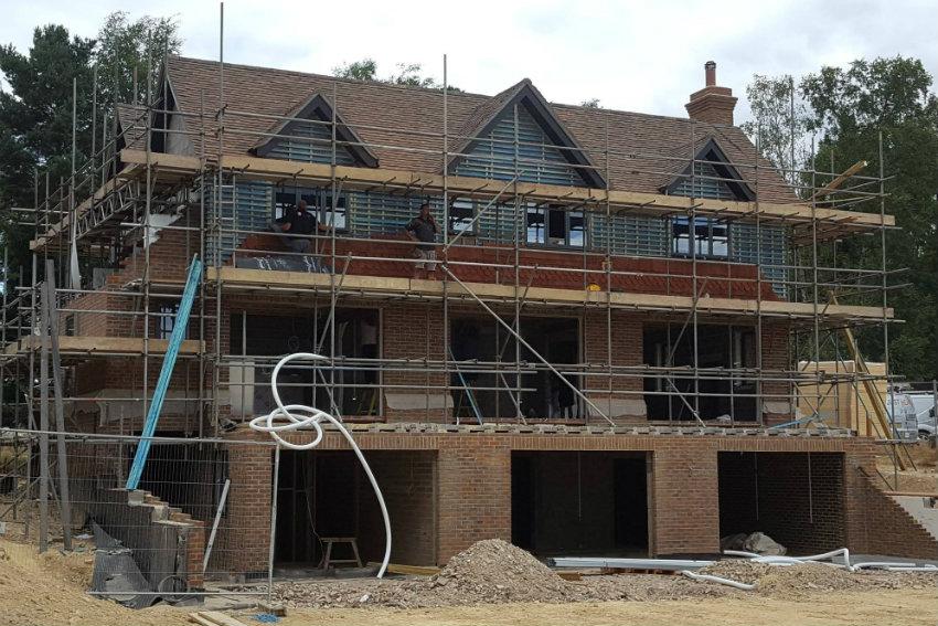 house-building-elenge-plat-colgate-horsham-exterior-view-roof-tiles-850.jpg