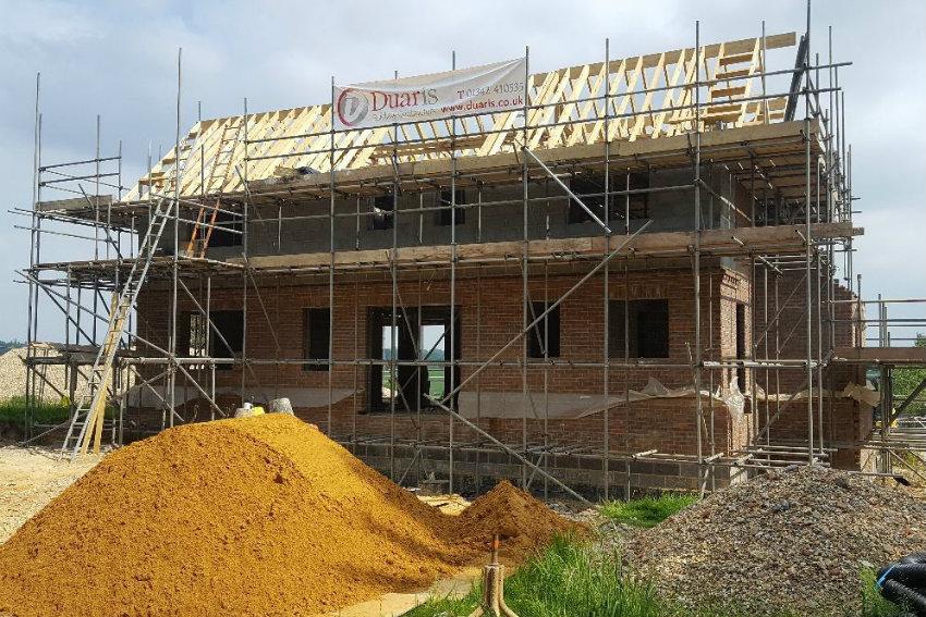 house-building-elenge-plat-colgate-horsham-exterior-view-sand-850.jpg