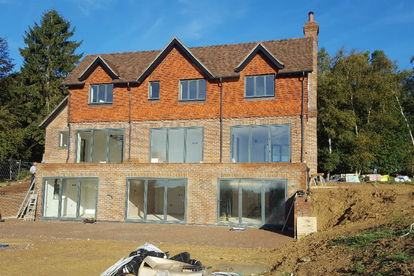house-building-elenge-plat-colgate-horsham-exterior-view-back-house-850.jpg