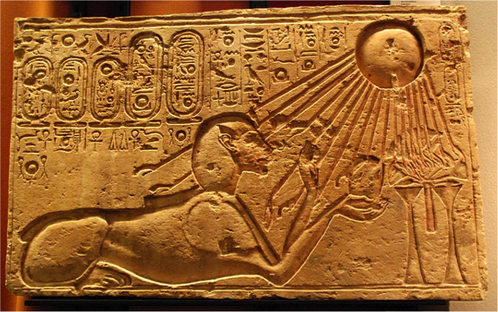 This stone block portrays Akhenaten as a sphinx and was originally found in the city of Amarna. It is now located in the Kestner Museum in Hanover, Germany. – Photo: Wikimedia, Hans Ollermann