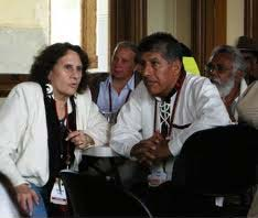 Wiccan Rachael Watcher translates for Argentine indigenous leader Raul Mamani, at an interfaith gathering.