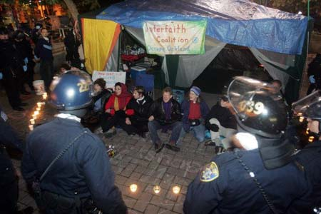 The police allow the Interfaith canopy to remain after the other tents at Oscar Grant Plaza were removed.