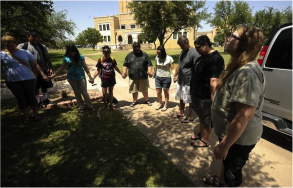 A group of McMurry University students gather in prayer as they prepare to leave for India. – Photo: Abilene Reporter-News, Thomas Metthe