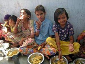 Village children enjoy a BK provided lunch. Photo: RB Sharone