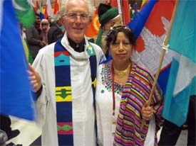 Marcus Braybrooke, standing with Yoland Trevino, then chair of United Religions Initiative Global Council, at the 2009 Parliament of the World's Religions in Melbourne.