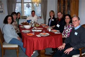 New friends gather in a home for an Interfaith Dinner Dialogue.