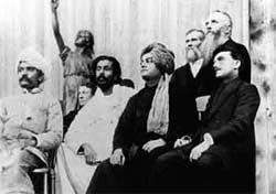 The two men in the middle, Anagarika Dharmapala, in white, and Swami Vivekananda, in the turban, share the platform with other dignitaries at the 1893 Parliament.