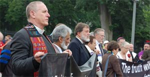 Rev. Ed Bacon, l., protesting in front of the White House last June against torture.