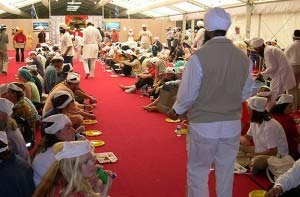 Langar, a free meal, is served by the Sikh community to the thousands attending the Barcelona Parliament of the World's Religions in 2004. Photo: Rowan Fairgrove