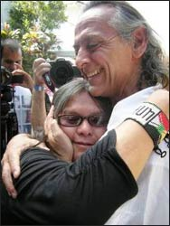 Francisco Ortiz, initiator of Day One, embraces Mona Palacca, of the 13 Indigenous Grandmothers