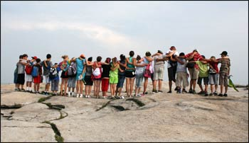 Climbing Stone Mountain in Georgia, a steep climb on a hot day, new interfaith friends spurred each other on to the top at the Kids4Peace camp. – Photo: Kits4Peace