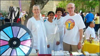 "Along with the indoor programs, ""Seeds of Peace"" featured an outdoor festival with numerous booths such as this Brahma Kumaris table."