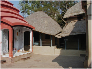 The small house at Kamarpukur where Ramakrishna lived (centre). The family shrine is on the left, birthplace temple on the extreme right (from the original). On The Birth Of The Interfaith Movement           – Photo: Wikipedia, Alan Perry