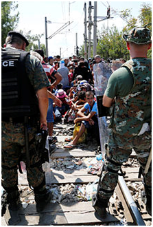 Migrants being stopped at the Greek–Macedonian border near Gevgelija by the Macedonian Police, 24 August 2015. Photo: Wikiped