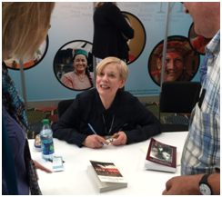 Karen Armstrong signing books at the Parliament of the World's Religions, October 2015 – Photo: TIO