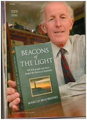 "Marcus Braybrooke holds up his Beacons of the Light, recently republished. It provides short but rich biographies of 100 ""holy people"" who over the centuries have influenced world religion. – Photo: Amazon"