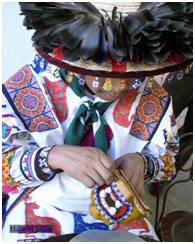 Huichol working on a beaded jaguar head – Photo: Wikipedia, Mario Jareda Beivide