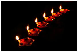 Diyas (oil lamps) bring light to a Diwali night – Photo: Wikipedia, Ramnath Bhat