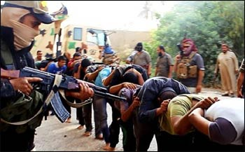An ISIS photo purporting to show the execution of Iraqi Shias. – Photo: The Telegraph