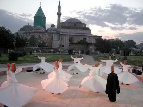 Whirling dervishes, whirling as a spiritual practice for remembering God, at the tomb of Rumi in Konya, Turkey – Photo: Wikipedia