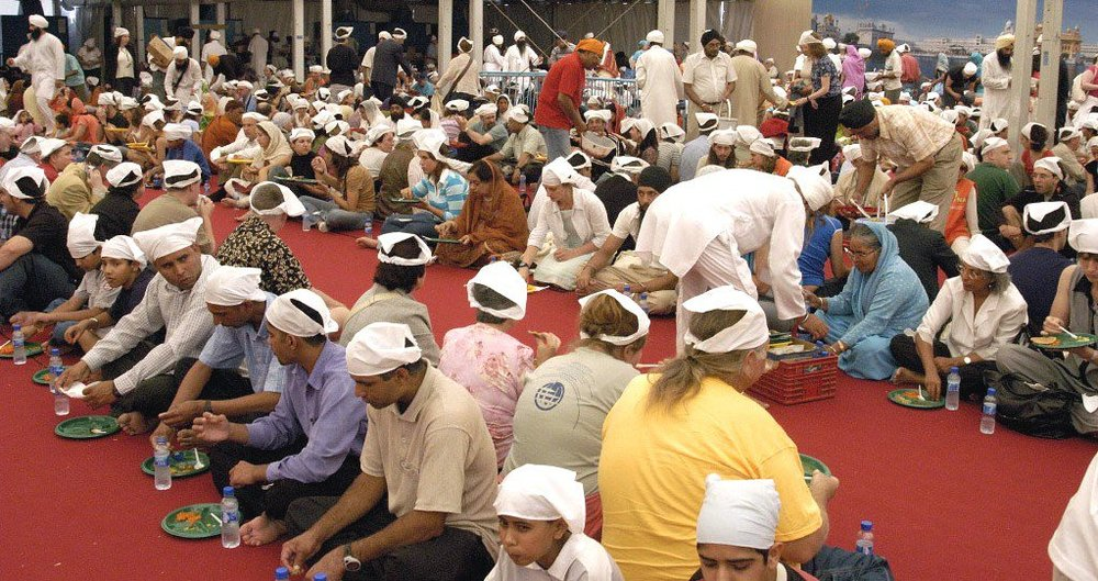 Langar was served daily to thousands attending the Barcelona Parliament of the World's Religions in 2004, a tradition which has continued at Parliament gatherings, most recently in Salt Lake City in 2015. – Photo: SikhiWiki