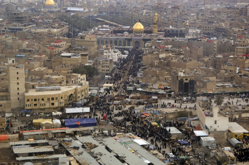 Millions work their way towards the  Imam Husayn Shrine in Karbala. – Wikimedia, Denny Cantrell