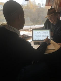 Yom Kippur prayers being read on Slavyanka's train ride to St. Petersburg. – Photo: Bettina Gray