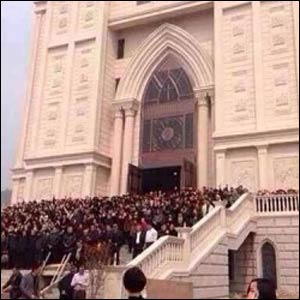 Church members protest government plans to demolish their new sanctuary. – Photo: Asia News