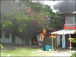 Homes being burned in the 2012 rioting between majority Buddhists and minority Muslims in western Myanmar. – Photo: Wikipedia