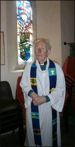 Rev. Marcus Braybrooke in clerical robes.