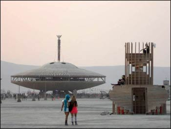 Burning Man stands high above the 'flying saucer,' all of it burned the final evening.