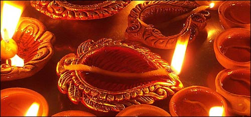 "A diya, the traditional lamp of Diwali, is customarily made of clay and symbolizes the ""Festival of lights."" Paramount to Hindu philosophy is the Atman, something beyond the physical that is pure, infinite, and eternal; it is the awakening to this ""Inner Light"" that Diwali represents. Photo: Courtesy of RTS and Wikimedia Commons"