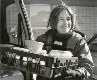 Jill Bullard back when the Food Shuttle began, inspired by the day she bought and gave away 11 breakfast sandwiches. – Photo: Inter-Faith Food Shuttle